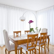 Modern dining room with white curtains  — Stock Photo