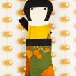 Japanese doll on funky background - Stock Photo