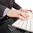 Close-up of businessman's hand touching computer keys during work - Stock Photo