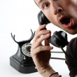 Young man talking at the telephone — Stock Photo #14543995