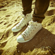 图库照片: Shoes on the sand