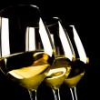 Stock Photo: Three glasses of white wine on black background
