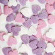 Heart shaped candy sweets on white background — Stock Photo