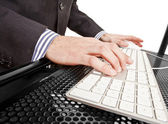 Close-up of businessman's hand touching computer keys during work — Stock Photo