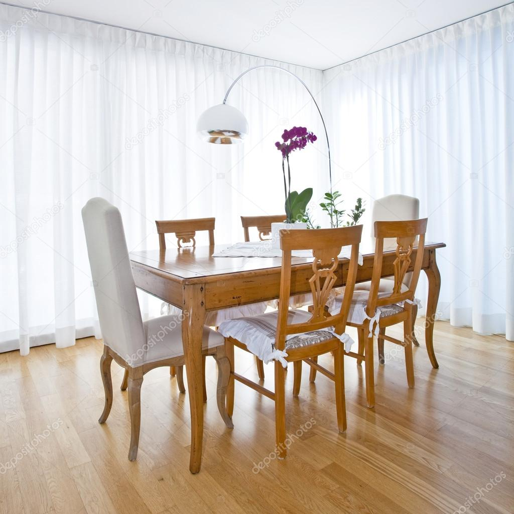 Modern dining room with white curtains stock photo for Modern dining room curtains