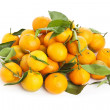 Ripe tasty tangerines with leaves isolated on white — Stock Photo #15889027