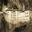 Predjama castle in the cave, slovenia - Stock Photo
