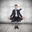Young businessman levitating in yoga position, meditation — Stock Photo