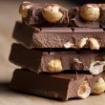 Chocolate with hazelnuts — Stock Photo #23096936
