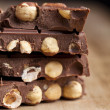 Chocolate with hazelnuts — Stock Photo