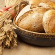 Stock Photo: Assortment of fresh baked bread on wood table