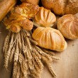 Assortment of fresh baked bread on wood table  — Stock Photo
