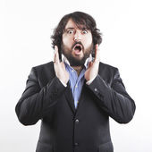Portrait of shocked businessman with beard — Stock Photo
