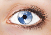Surrealistic picture of a woman's eye with the sky in it — Stock Photo