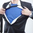Young businessman acting like a super hero and tearing his shirt off — Stock Photo #28459973