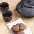 Delicious chocolate heart shape biscuits with tea — Stock Photo
