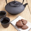 Delicious chocolate heart shape biscuits with tea — Stockfoto