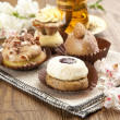 Stock Photo: Different sort of beautiful pastry, small colorful sweet cakes with tea