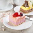 Stock Photo: Beautiful pastry, little colorful sweet cakes with tea
