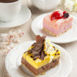 Beautiful pastry, little colorful sweet cakes with tea — Stock Photo