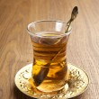 A glass of turkish tea on wooden table — Stock Photo