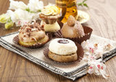 Different sort of beautiful pastry, small colorful sweet cakes with tea — Stock Photo
