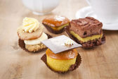 Delicious cupcake pastry on wooden background table — Stock Photo