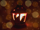 Lantern with burning candles and boke — Stock Photo