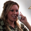 A girl talks on the phone. — Stok video