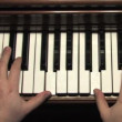 Playing the piano. — Stock Video