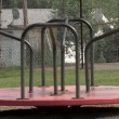 An empty carousel spins in a playground — Stock Video