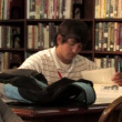 Students study in the library — Stock Video #13491866