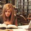 Stock Video: A female college student studies in the library
