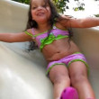 A young girl slides down a sliding board.  Set of two clips — Stock Video