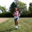 Stok video: A young girl runs towards the camera.