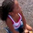 Stok video: A young girl plays at the playground.