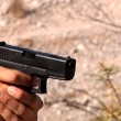 Firing a gun in the desert. — Stock Video