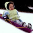 A little girl goes sled ridding. Slow motion. — Stock Video