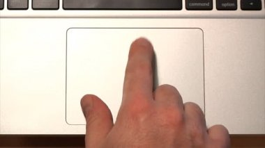 Demonstrating the various uses of a laptop's multi-gesture trackpad. — Stock Video