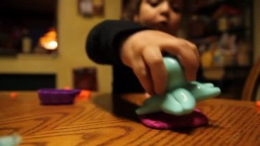 A young girl plays with clay. — Stock Video