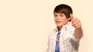 A young boy gives the camera a thumbs-up. — Stock Video