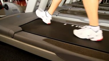 A man walks on a treadmill.