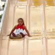 A girl slides down a large slide at a carnival. — Stock Video #14566763