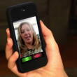 Video chatting on a portable handheld device. — Vídeo de stock
