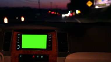 A man adjusts his in-dash GPS during a night drive. — Stock Video