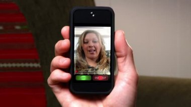 Video chatting on a portable handheld device. — Stock Video #14568079