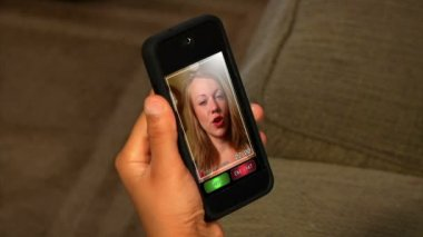 Video chatting on a portable handheld device. — Stock Video #14569129