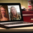 Two women video chat on a portable laptop computer. — Stock video #14763877