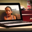 A young girl video chats on a portable laptop. — Stockvideo
