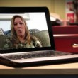 A young woman video chats on a portable laptop. — Wideo stockowe #14763929